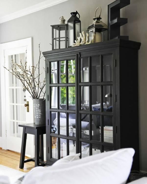 Стильный черный шкаф для гостиной
