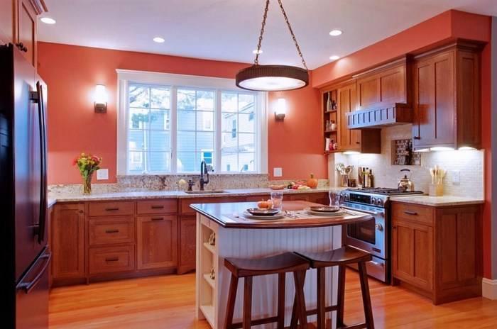Небольшой остров в кухне с красными стенами