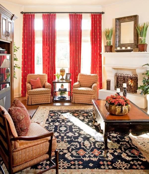 Дизайн гостиной с красными шторами