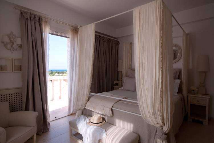 Дизайн спальни в отеле Borgo Egnazia