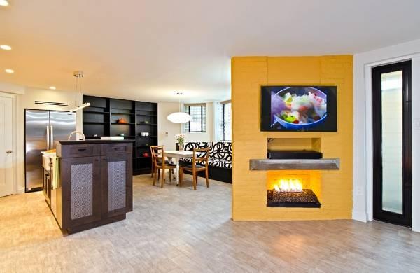 Камин в дизайне квартиры студии
