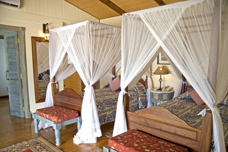 Дизайн спальни в отеле Anantara Medjumbe Island Resort & Spa