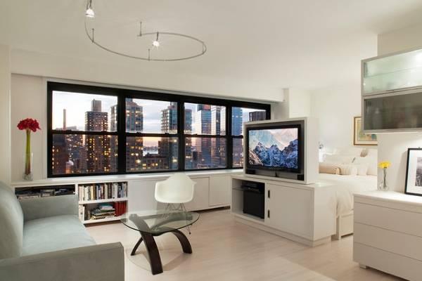 Удобный минималистский дизайн квартиры студии