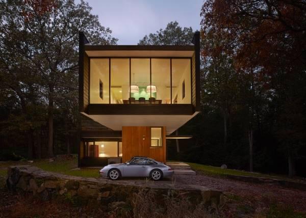 Современный дизайн частного дома с навесом