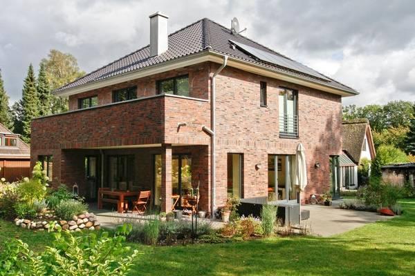 Красивые фасады домов - фото кирпичного дома