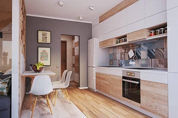Удобная кухня в дизайне квартиры студии 40 кв м