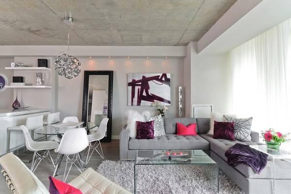Серый цвет стен в интерьере квартиры в стиле лофт