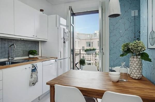 Кухня с балконом в однокомнатной квартире в скандинавском стиле
