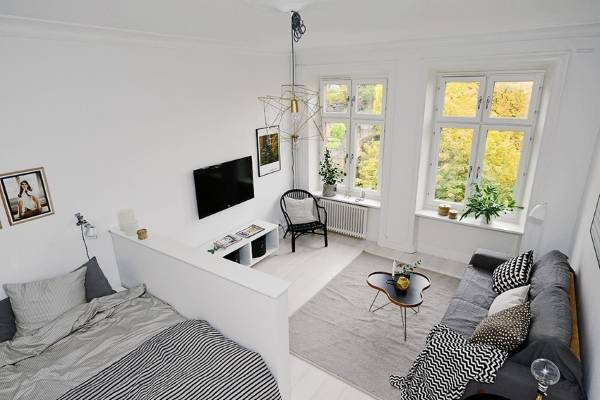 Однокомнатная квартира в скандинавском стиле - гостиная и спальня