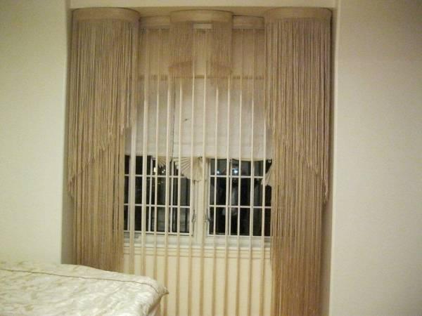 Необычный способ повесить шторы нити