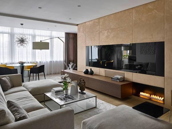 Декоративный бои камин в квартире - фото гостиной