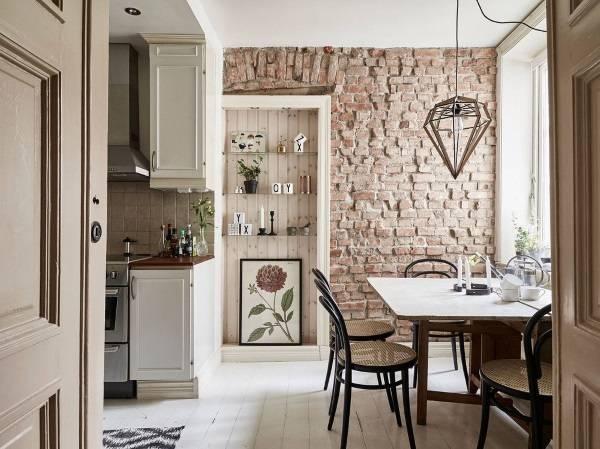 Как смотрится кирпичная стена в интерьере кухни