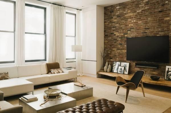Дизайн кирпичной стены в интерьере гостиной в современном стиле