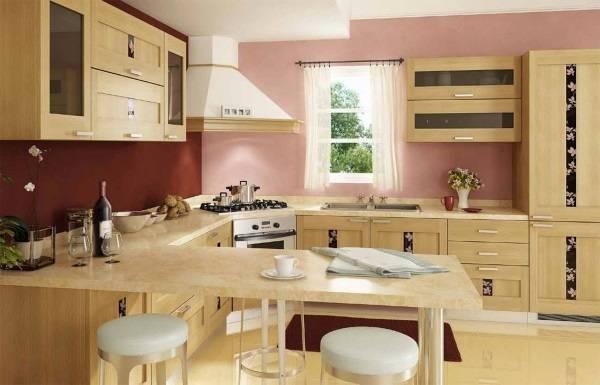 Интерьер угловой кухни с барной стойкой - фото в бежевых и розовых тонах