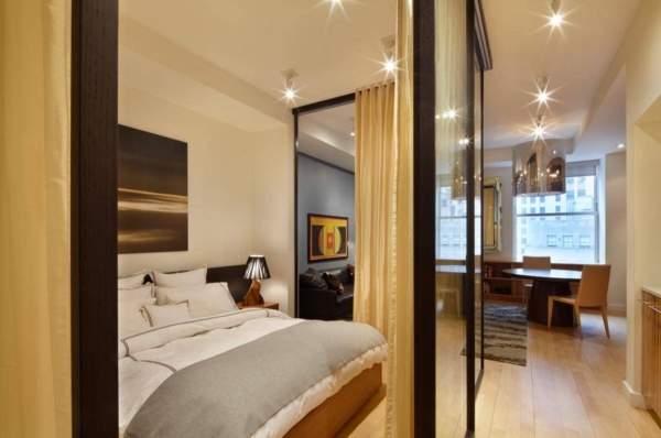 Дизайн однокомнатной квартиры для семьи с ребенком - как отделить спальню?