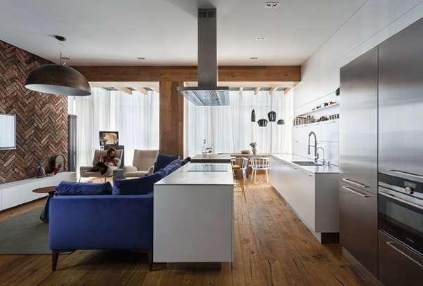 Современный интерьер гостиной кухни в частном доме