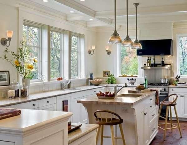 Дизайн маленькой кухни в частном доме - фото острова с обеденной зоной