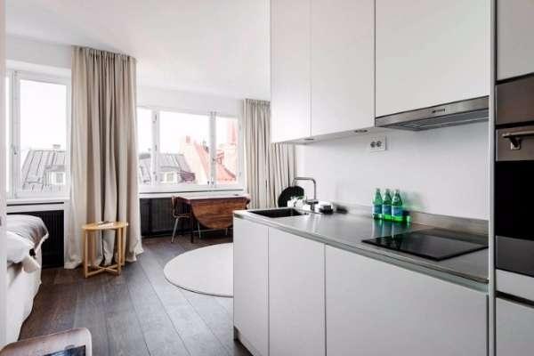 Дизайн кухни в маленькой квартире студии - фото в стиле минимализм