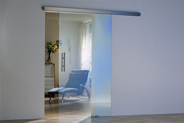 Откатные стеклянные двери межкомнатные из прозрачного стекла