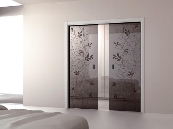 Раздвижные стеклянные межкомнатные двери - фото с растительным узором