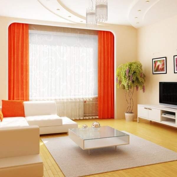 Дизайн зала в квартире в белом цвете с оранжевым декором