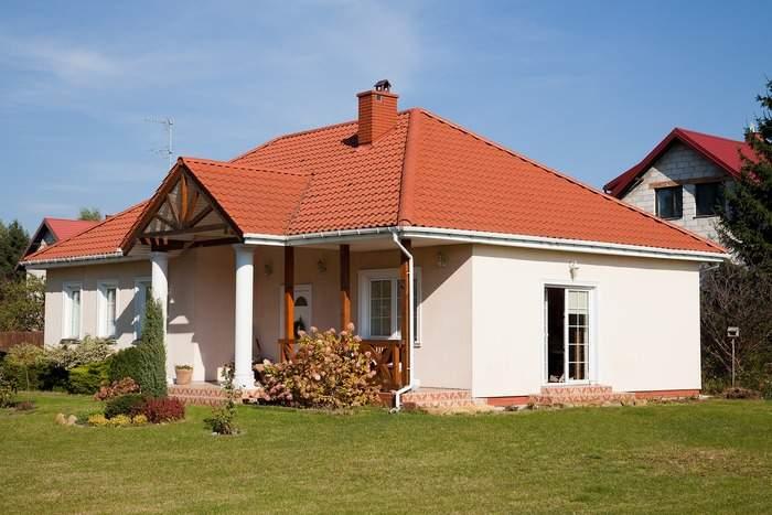 Фото фасадов частных домов со штукатуркой на стенах