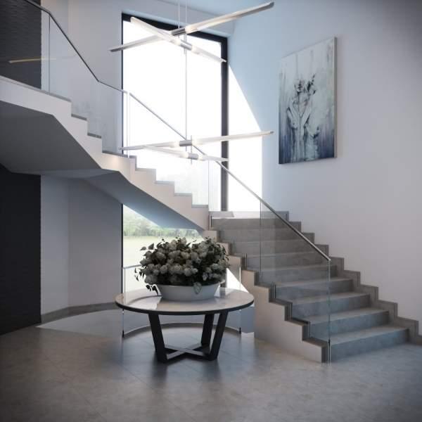 Бетонная лестница в частном доме с несколькими пролетами