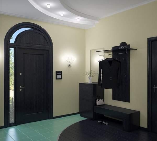 Черная мебель в современном дизайне прихожей в частном доме