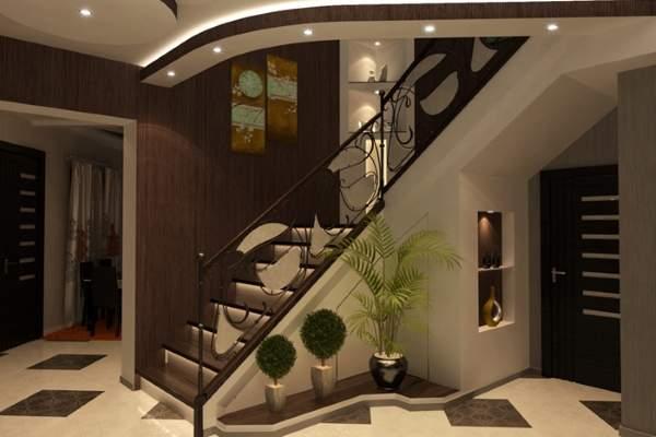 Дизайн прихожей с лестницей в частном доме в темных тонах