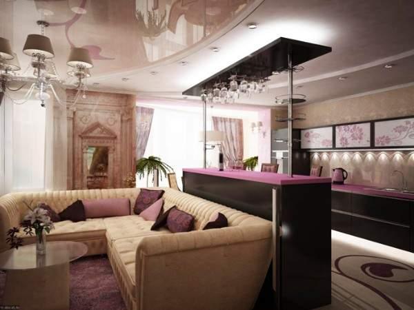 Интерьер кухни гостиной в частном доме с барной стойкой и натяжным потолком