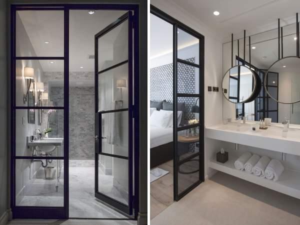 Стильные стеклянные двери для ванной в черной раме из металла