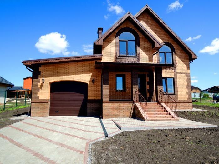 Современные проекты домов с гаражом под одной крышей фото