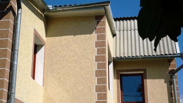 Штукатурка короед на фасадах домов, фото 13