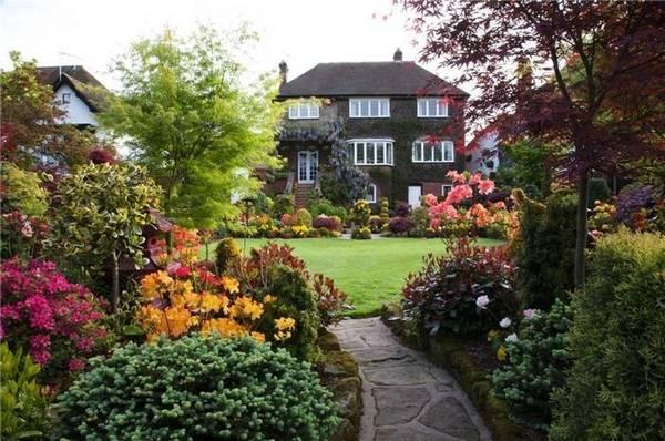 Ландшафтный дизайн двора частного дома, фото 8