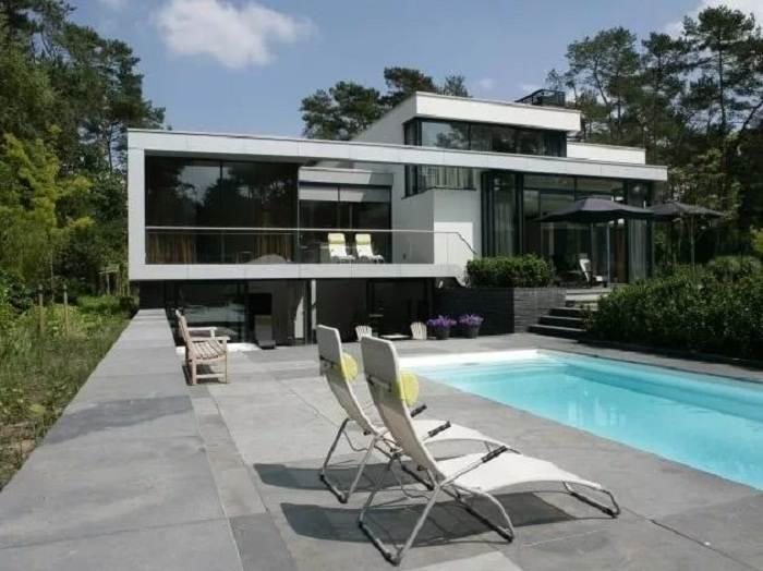 Дома с плоской крышей – современные тенденции и способы оформления на 28 фото