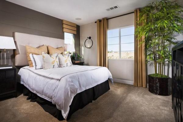 оформление интерьера спальни крупными тропическими растениями