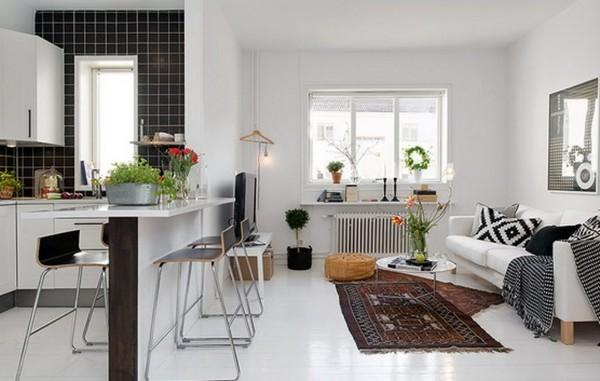 просторный дизайн с барной стойкой между гостиной и кухней