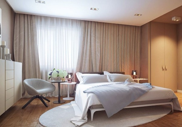 современный интерьер спальни ковёр овальной формы на полу