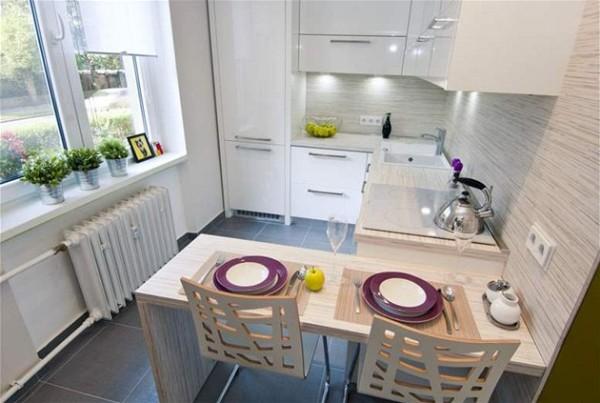 современный дизайн маленькой угловой кухни с барной стойкой