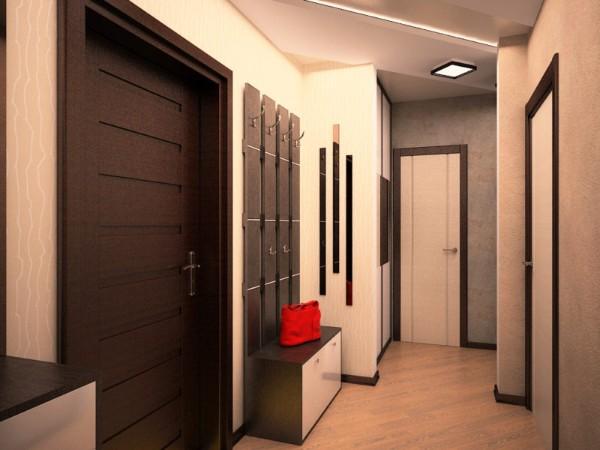 светлый дизайн коридора с темными дверными проёмами в квартире