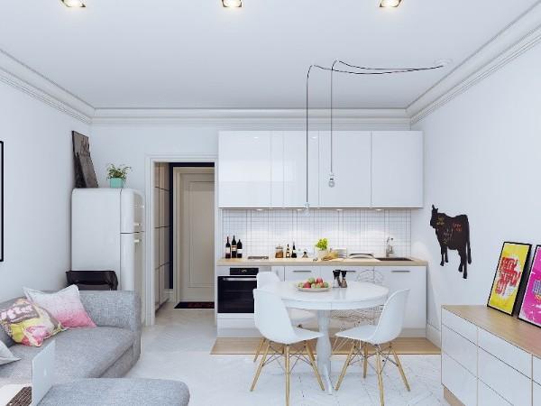 серо-белый дизайн кухни студии в небольшой квартире