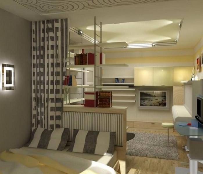 интерьер кухни студии со спальней