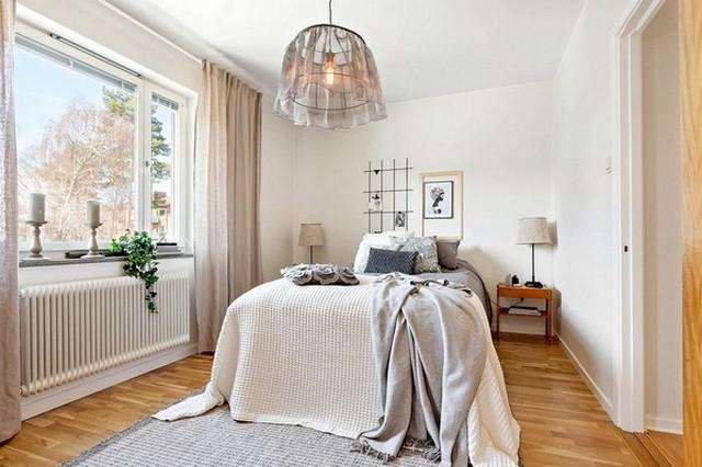 люстра над кроватью в спальню в скандинавском стиле