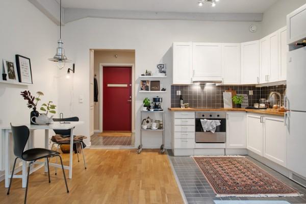 скандинавский стиль в интерьере кухни студии с обеденной зоной