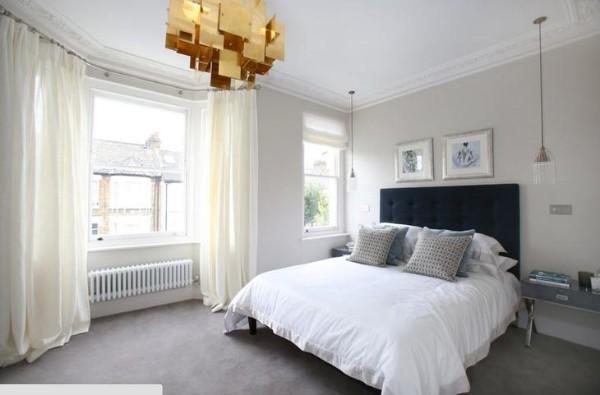 спальня в современном стиле золотистая люстра