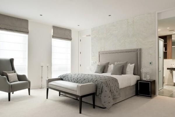 стильная современная спальня в сером дизайне