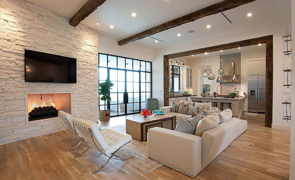 дизайн гостиной с камином в частном доме зал
