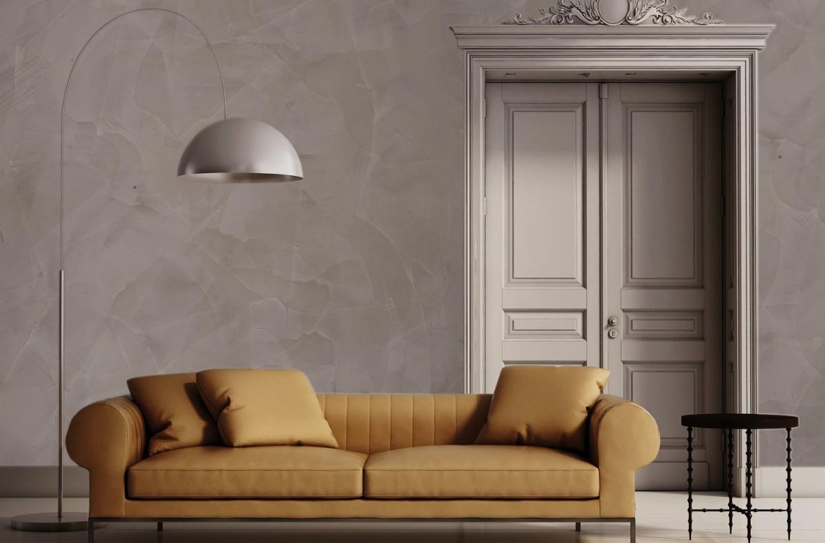 фактурная штукатурка светло-серого цвета в классическом интерьере гостиной