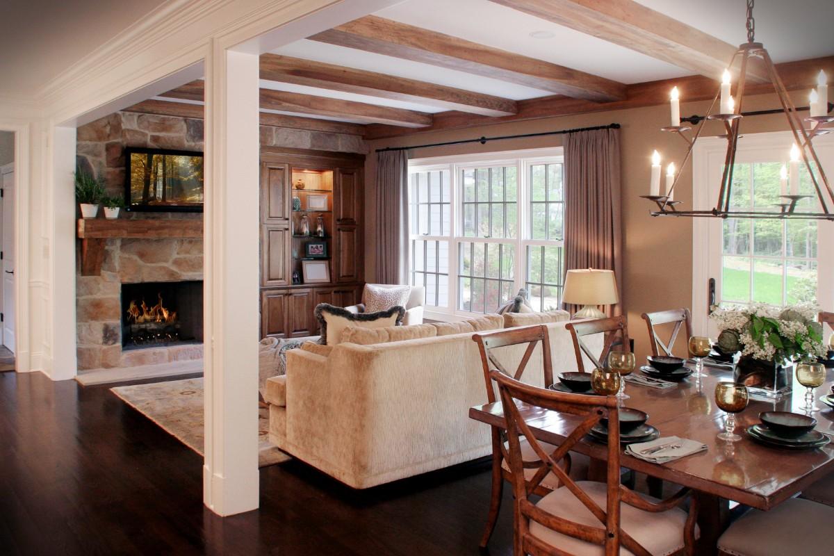 дизайн кухни гостиной в частном доме с камином