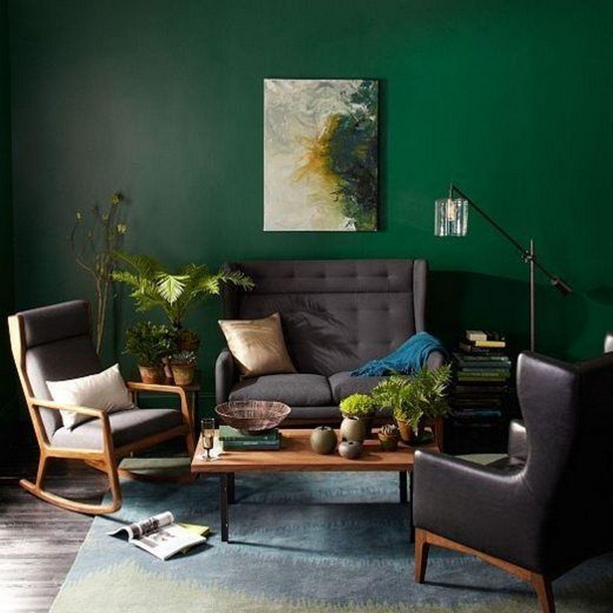 интерьер гостиной в чёрном цвете изумрудные стены